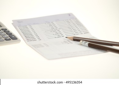 pencil and calculator on passbook. selective focus. Accounts concept.