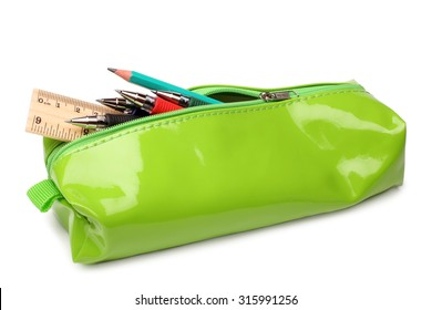 Pencil case with school supplies on white background