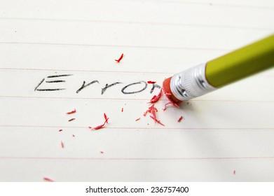 Pencil closeup erasing an error on paper