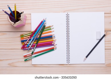 Pencil color drawing set on the wooden table