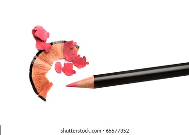 Pencil cosmetic sharpening with husk on white