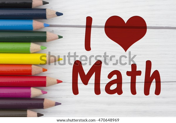 Pencil Crayons with text I love Math with weathered wood background
