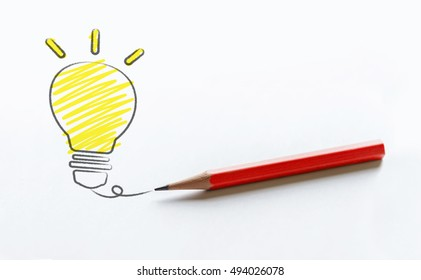 Pencil drawing light bulb on white paper, business idea concept, idea concept