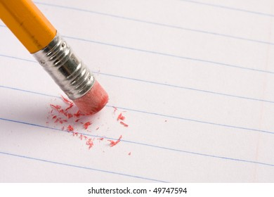 Pencil eraser on lined paper with eraser dust. Concept of education.