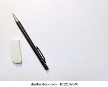 pencil and eraser on a white background