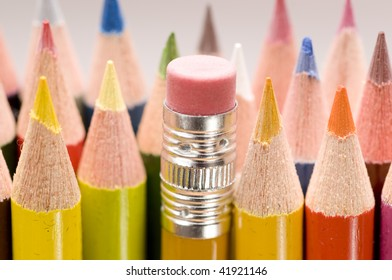 Pencil eraser stands out among group of colored pencils