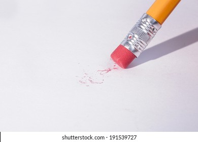 Pencil erasing on white page