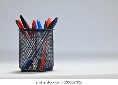 Pencil holder basket on white background.