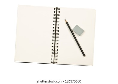 A pencil and kneaded eraser on a coil bound sketch book