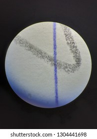 Pencil line is magnified by microscopes. Blue pen line is same. Pencil line made from many carbon dot then we see it black. Pen line from ink. It is very clear zooming. Can seeing details.