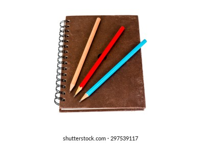 pencil and notebook isolated on white background