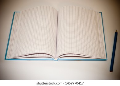 pencil and notebook on grey background