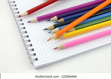 pencil on checked school paper of notepad