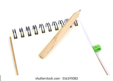Pencil on a notebook isolated on white background