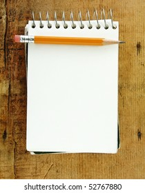 Pencil on small pad of paper blank for your text.