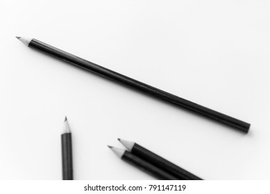Pencil one the white paper