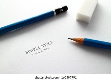 Pencil and paper your can write a text on a paper