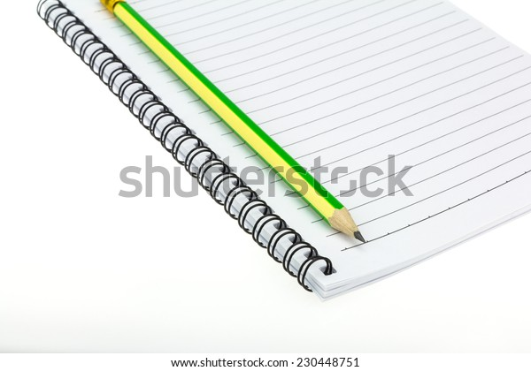 Pencil put on Paper note book  on white background