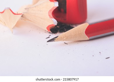 Pencil with red sharpener on white background isolated
