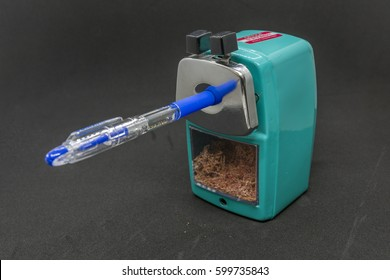 A pencil sharpener isolated with pen inside