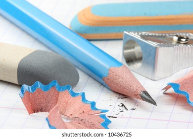 pencil, sharpener and two erasers