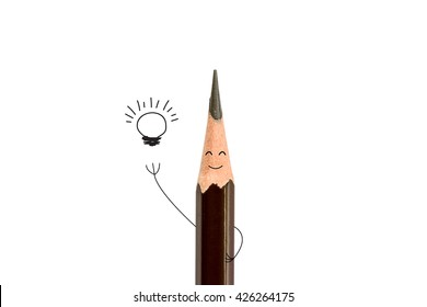 pencil smiling and light bulb on white, idea concept.