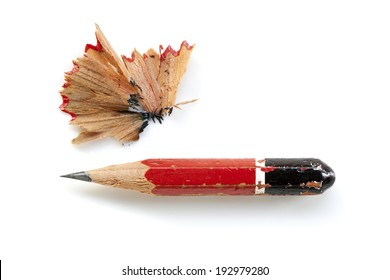 Pencil stub and shavings, isolated on white.
