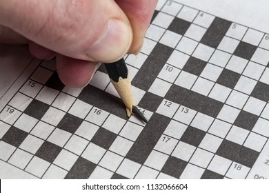 A pencil tip breaks while doing a crossword puzzle.