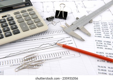 pencil, vernier caliper and calculator on plans and sheet number