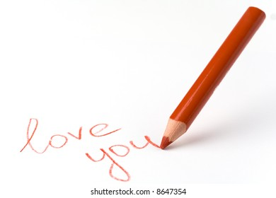 """pencil writing """"I love you"""" on a white background with copy space"""
