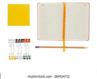 Pencil,notebook and paper clips on white background