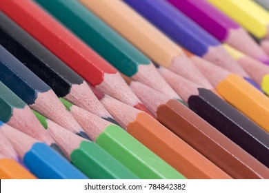The pencils of all colors are on the white background