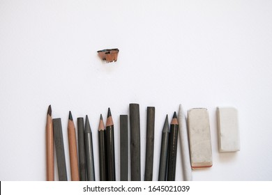 pencils, charcoal, eraser on paper. set for drawing graphics