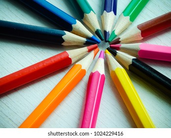 Pencils. Colour pencils. Stationery. Pencils lie on a wooden table.