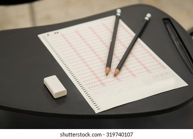 Pencils and eraser put on Optical mark recognition sheet in examination room, ORM Sheet, Concept for article