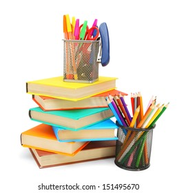 Pencils and felt-tip pens in baskets with books. On a white background.