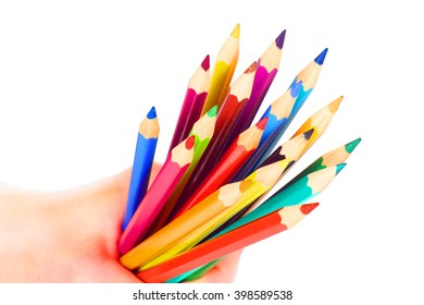 Pencils in hand isolated on white background