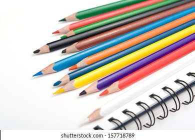 Pencils and the jotter closeup isolated
