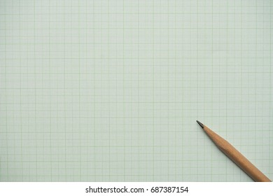 pencils on graph paper, research and education concept