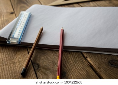 Blueprint pen ruler images stock photos vectors shutterstock pencils and ruler near white sheet of paper malvernweather Choice Image