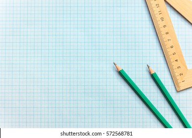 Pencils with ruller on the graph paper.