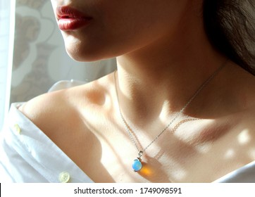 pendant around the neck . beautiful collarbone girls . pendant on the collarbone .