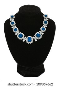 Pendant with blue gem stones on black mannequin isolated on white