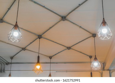 Pendant lighting and electrical conduit on the ceiling, electrician maintenance, led light bulbs, handyman, craftsman, electric, design interior