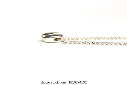 pendant made of silver in the form of a coffee zorn, on a chain lies on a white background. Jewelry, pendant for coffee lovers. Memorable gift, relationship, love. Coffee day