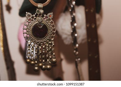 Pendant of an old necklace with a precious violet colored gem in the center.