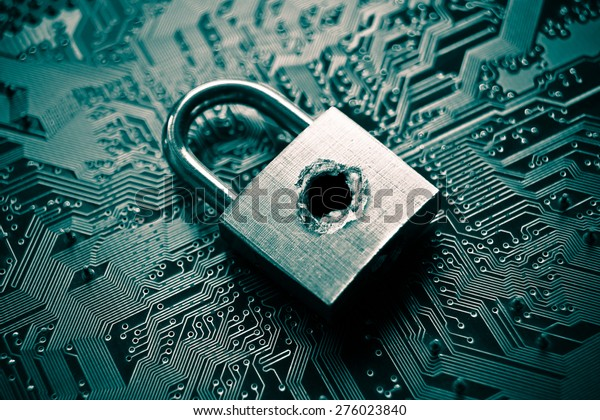 A penetrated security lock with a hole on computer circuit board background