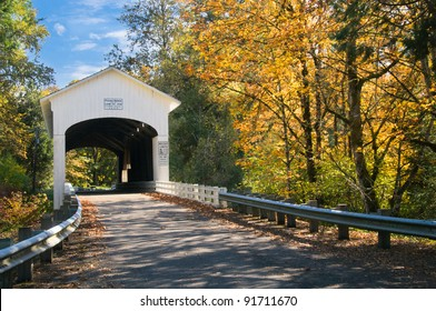 The pengra covered bridge with dappled sun shining through fall leaves; one of many in Lane County, Oregon near Eugene.