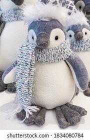 A penguin stuffed toy Christmas decor.