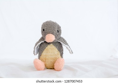 Penguins doll on a white background.